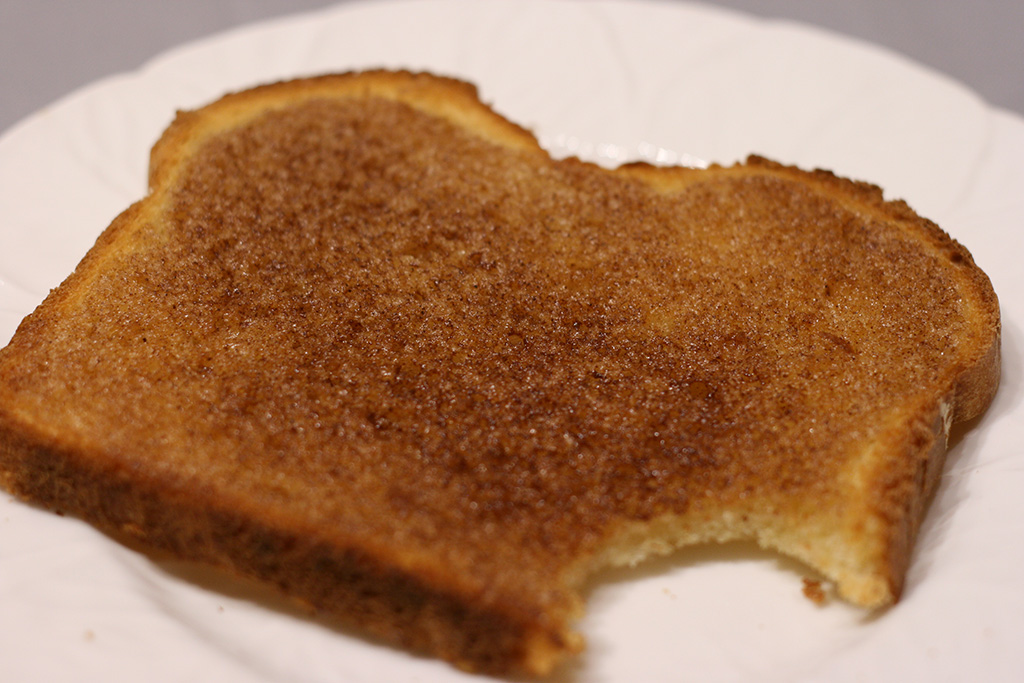 maple cinnamon toast with a bite taken