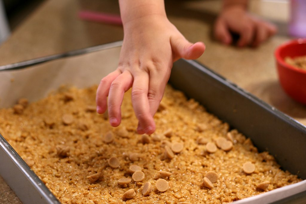 Adding peanut butter chips to the crispy chocolate peanut butter bars