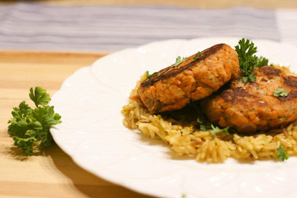 salmon patties on a bed of rice pilaf