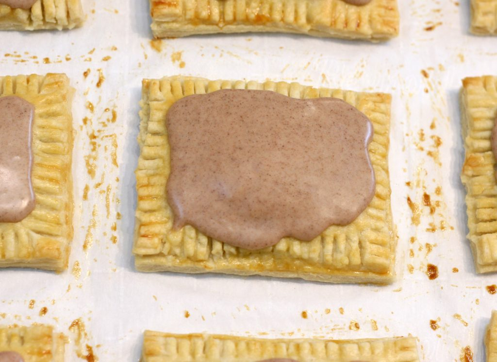 Finished toaster pastries on parchment paper