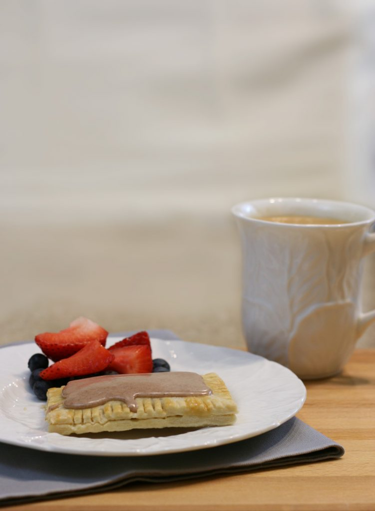 Toaster pastry with fruit and coffee