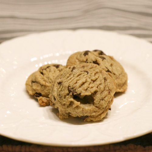 3 of Chloe and Dad's Famous Peanut Butter Chocolate Chip Cookies on a plate.