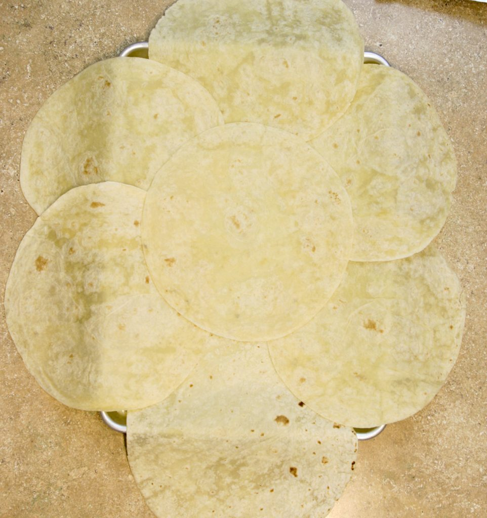 tortillas laid out on sheet pan